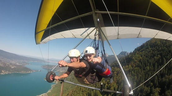 Tandem hang gliding over lake Annecy and the Alps