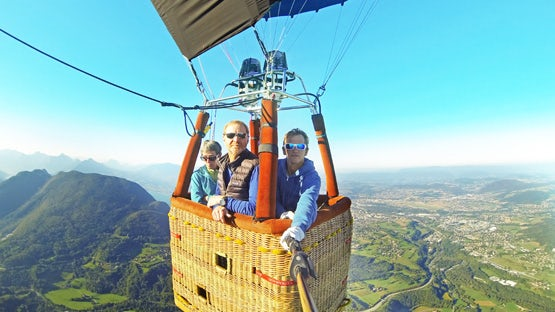 Hot air ballooning over the French Alps and lake Annecy