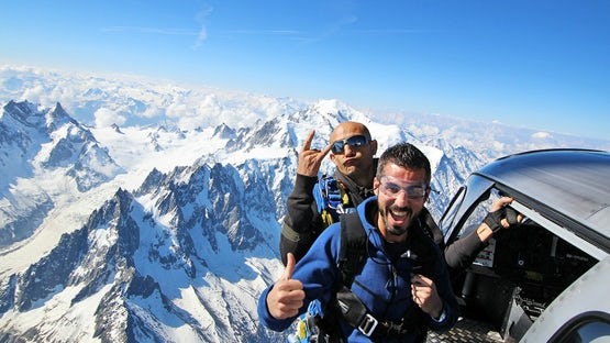 Tandem free fall parachuting in the Alps