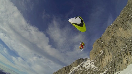Tandem paragliding on skis in the French Alps